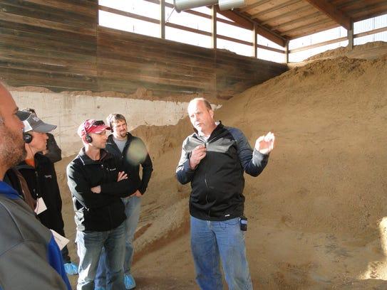 Dr. Bob Nagel, Holstum Dairy, Hilbert, shows the recycled