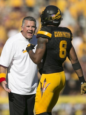 ASU head coach Todd Graham shouts at ASU defesnive back Lloyd Carrington during the second quarter of the college football game against Washington at Sun Devil Stadium in Tempe on Saturday, Nov. 14, 2015.