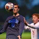 Salem's Jamie Crosby (No. 8) and Jason Warras look to maintain possession of the ball, while Canton's Matt Rockafellow closes in.