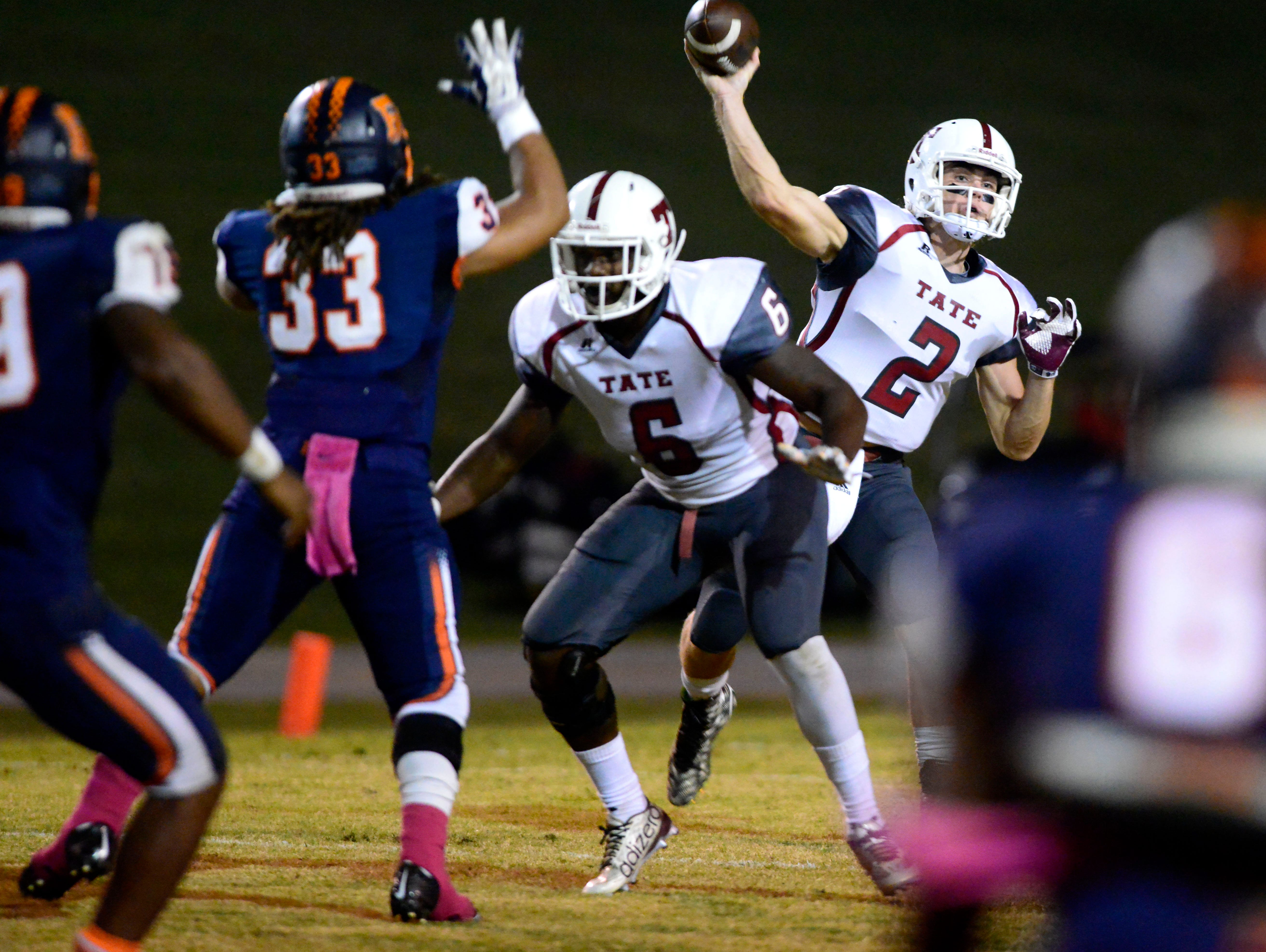 Tate High School quarterback Sawyer Smith locks on to a receiver Friday in a game against Escambia High. Tate beat Escambia 35-14.