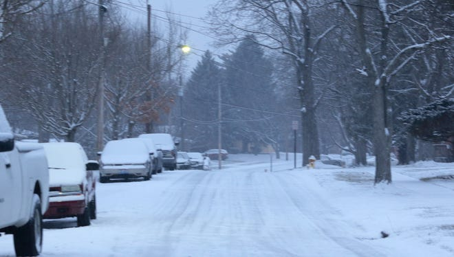Cascade Road in Forest Park is snow covered Wednesday morning.