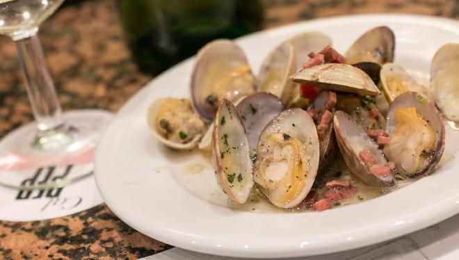 The clams, big and small, are garlicky delicious, as are the squid a la plancha.