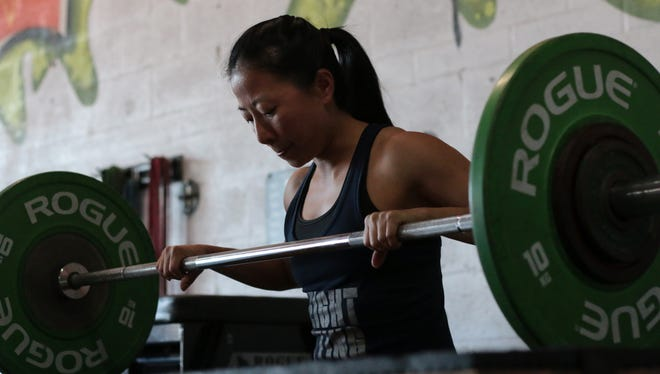 Naples weightlifter Janet Chow visualizes her lift at Crossfit Blaze in North Naples on Thursday, March 29, 2018. Chow, along with Estero residentJanine Giovinazzi, will competeat the National Masters Weightlifting Championshipin Buffalo, New York from April 5-7.