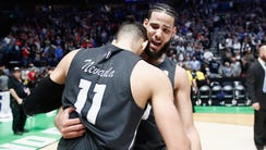 Caleb Martin celebrates with Cody Martin of the Nevada