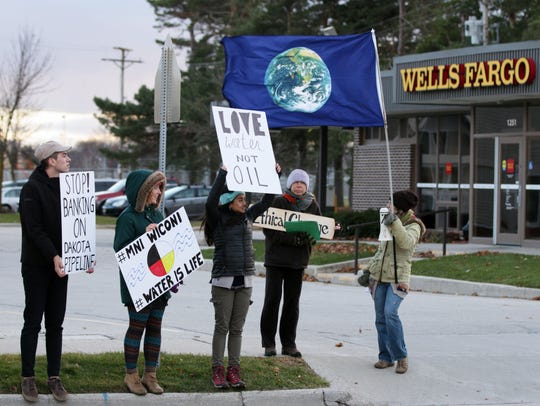 Sheboygan protesters hold signs Dec. 1, 2016, that