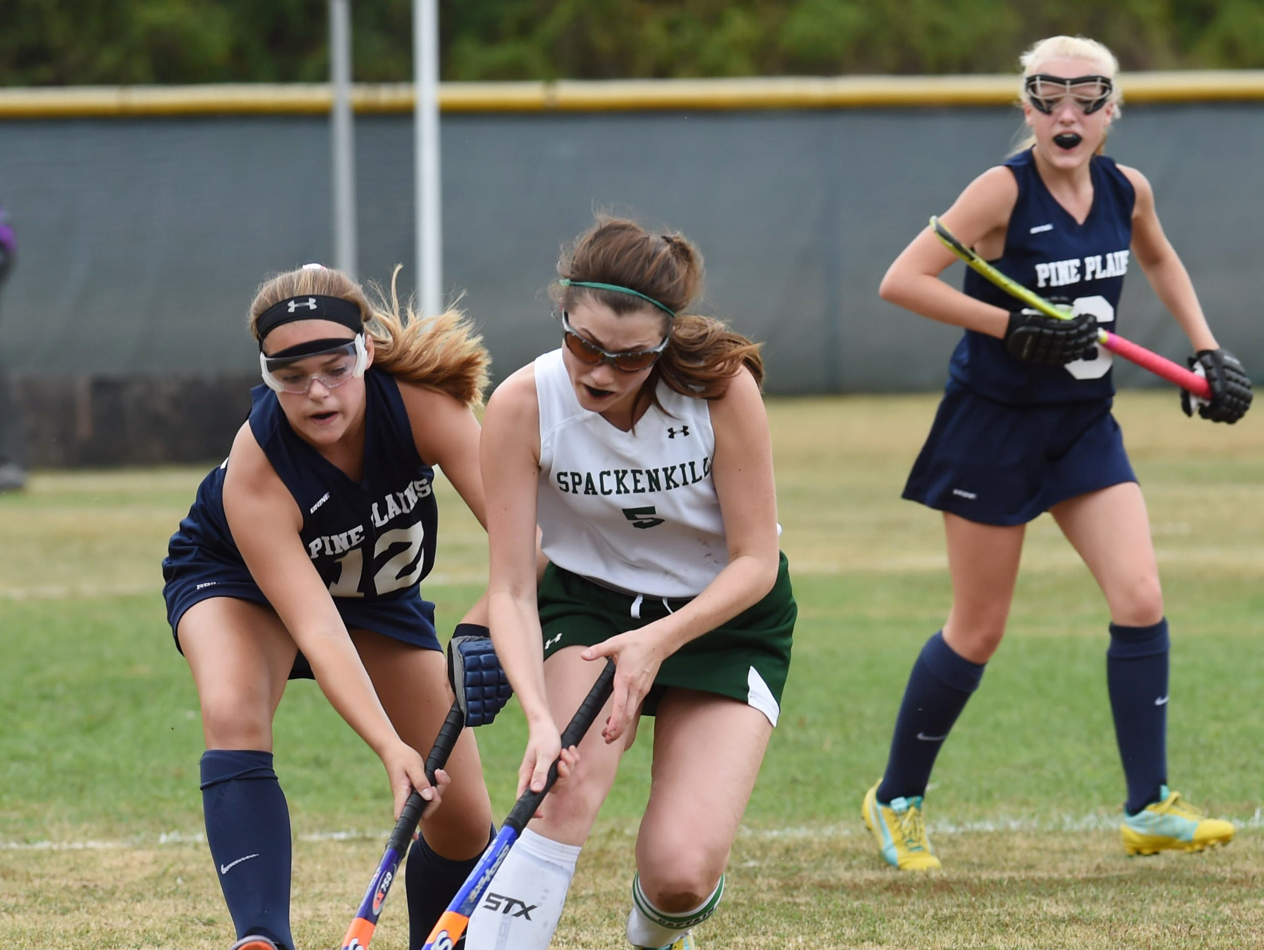 Spackenkill's Sarah Bowen, center, tries to keep the ball away from Pine Plains' Sadie Norman, left, during Monday's game.