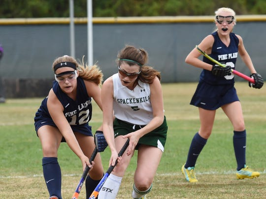 Spackenkill's Sarah Bowen, center, tries to keep the