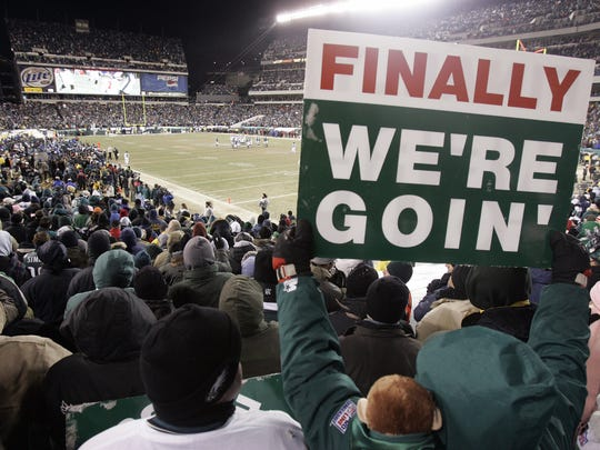 A Philadelphia Eagles fan holds a sign celebrating the Eagles NFC championship win against the Atlanta Falcons in the final moments of the fourth quarter in Philadelphia Sunday Jan. 23, 2005.  The Eagles defeated the Falcons 27-10 and are headed to the Super Bowl.