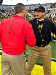 Jim Harbaugh and Urban Meyer will meet for the third time Saturday.