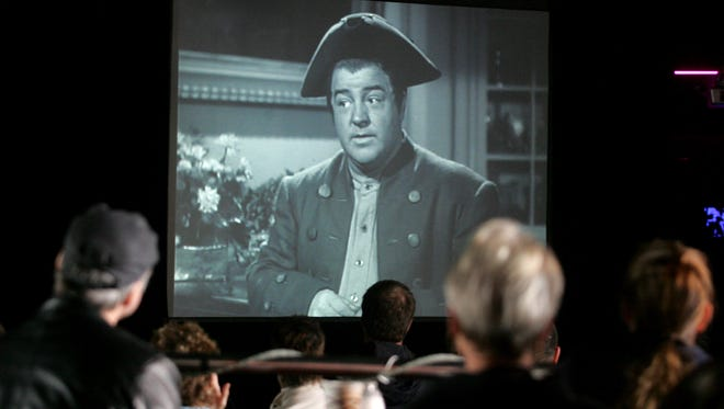 """Viewers watch the 1946 Abbott and Costello film """"The Time of Their Lives"""" at the Wonder Bar in Asbury Park during the 2008 Garden State Film Festival."""