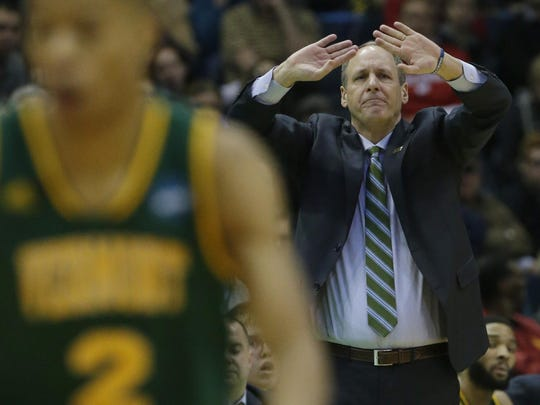 Vermont head basketball coach John Becker is shown during their first round game of the NCAA Division I Men's Basketball Tournament game against Purdue Thursday, March 16, 2017 at the BMO Harris Bradley Center in Milwaukee. Purdue won, 80-70.