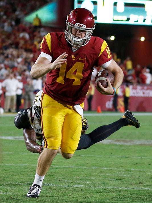 Southern California quarterback Sam Darnold (14) runs in a touchdown during the second half of an NCAA college football game against Arizona State on Saturday, Oct. 1, 2016, in Los Angeles. (AP Photo/Ryan Kang)