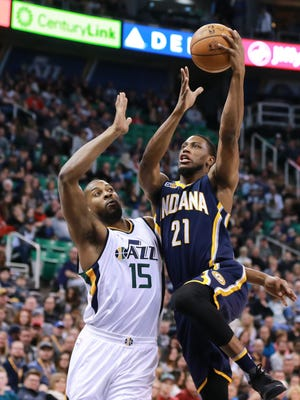Indiana Pacers forward Thaddeus Young (21) shoots the ball as Utah Jazz forward Derrick Favors (15) defends during the first quarter at Vivint Smart Home Arena.