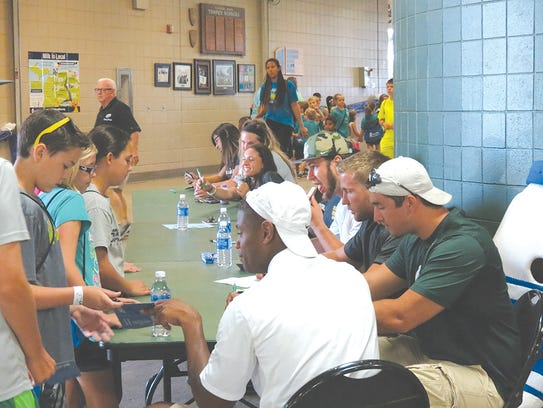 Several MSU athletes visited with the youth that participated
