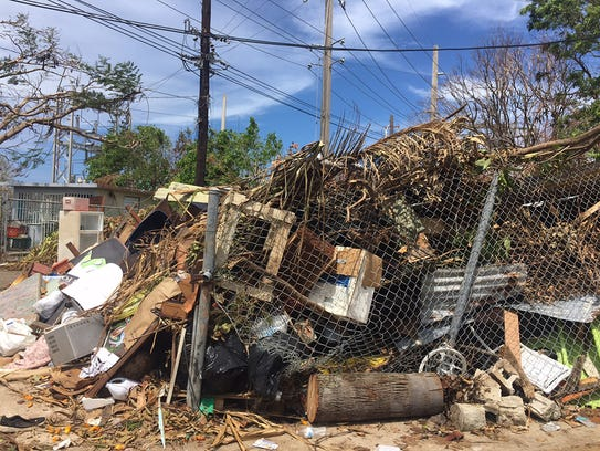 Scattered debris and building damage in a remote area