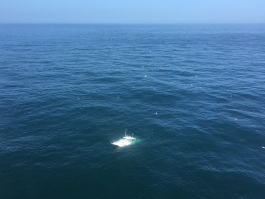 A Coast Guard helicopter and boat crews rescued six