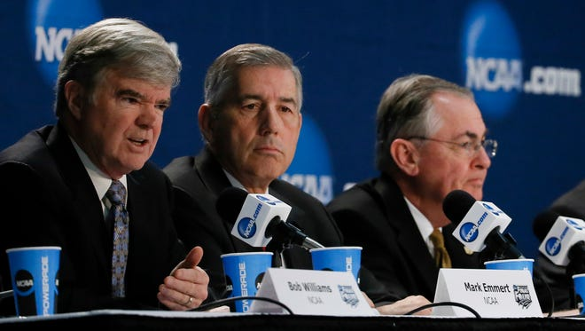 NCAA president Mark Emmert, Big 12 commissioner Bob Bowlsby, and Wake Forest University president Nathan Hatch,