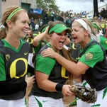 Oregon's Hailey Decker, center, celebrates with teammates after their victory against North Carolina State on Saturday, May 23, 2015, in Eugene, Ore.