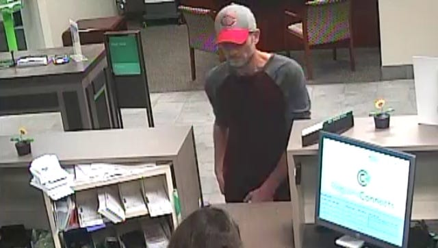 Surveillance footage from inside a Regions Bank in Mooresville, Ind., shows a man believed to be Robert E. Neal passing a note demanding money to a teller.