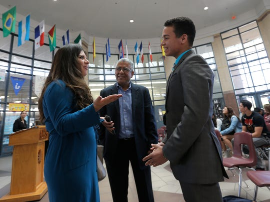Americas High School student and government ambassador for Libertas Academy Ricardo Flores talks with state Rep. Mary González, D-El Paso, after a news conference to announce the magnet school's upcoming immigration conference.