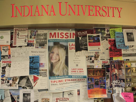 A poster seeking information about missing Indiana University student Lauren Spierer is seen amongst dozens of other flyers on a public message board in the Indiana Memorial Union, Friday, Sept. 2nd, 2011.