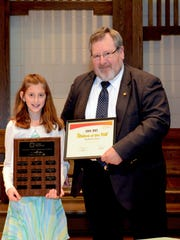 Newman Catholic Elementary School: St. Mark Student of the Year Madeline Poole was honored as Student of the Year at Newman Catholic Elementary School: St. Mark. Thad Streeter from the Catholic Financial Life presented Poole with a savings bond and certificate. Also, a plaque with her name on it will be displayed in the school office. Poole was chosen for outstanding leadership, academic diligence, and citizenship.