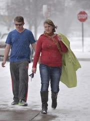 """It probably wasn't the most pleasant day to make the brief and coatless trek from one building to the other for a theater practice Tuesday afternoon, Feb. 2, but Cathedral High School students Spencer Neisen, a sophomore, and Carrie Sowada, a freshman, weren't complaining about it. """"I love snow. I have a winter birthday, so snow is my favorite thing,"""" Sowada said."""