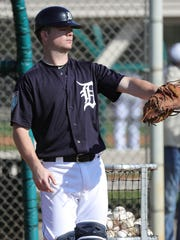 Detroit Tigers catcher Jake Rogers watches infield drills during spring training Thursday, Feb. 15, 2018 at Publix Field at Joker Marchant Stadium in Lakeland, Fla.