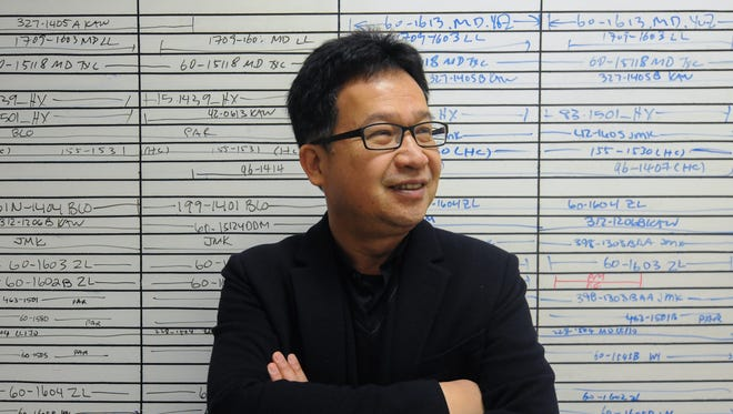Benjamin Chien, CEO and founder of QPS Holdings, is seen in the company's lab in Newark on Feb. 18, 2016.