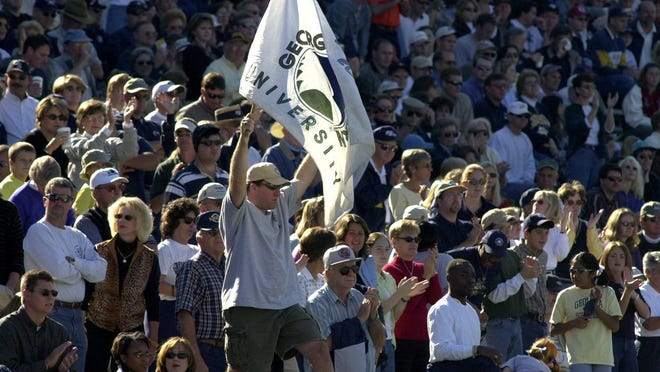 Georgia Southern fans celebrate during a football game against Elon College at Paulson Stadium in Statesboro.