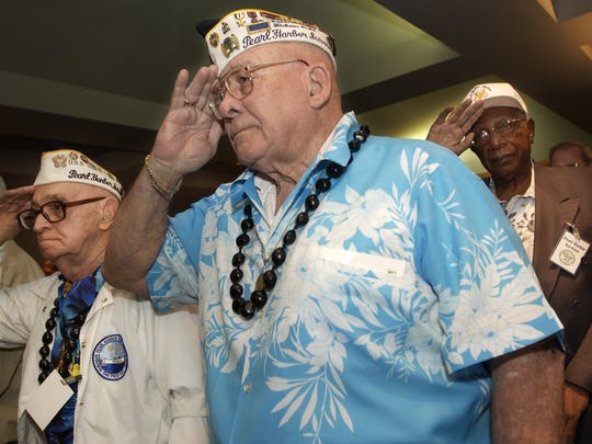 Pearl Harbor survivors, from left, Harold Harriman,