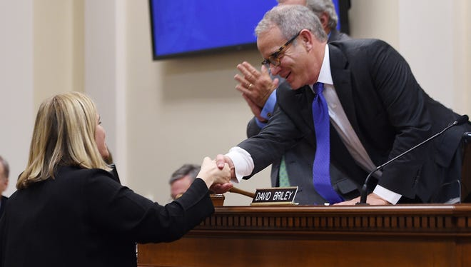 Vice Mayor David Briley, right, shakes hands with Mayor Megan Barry after she addresses the new Metro Council during its first meeting  Oct. 6, 2015 at City Hall.