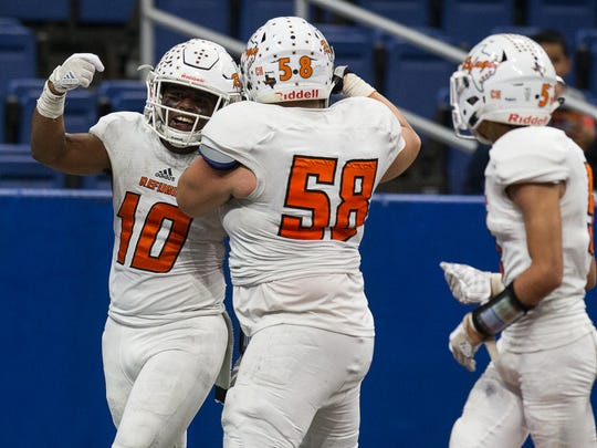 Refugio's Jacobe Avery celibates after scoring a touchdown during the fourth quarter of the Class 2A Division I state quarterfinal against Mason at the Alamodome in San Antonio on Friday, Dec. 8, 2017.