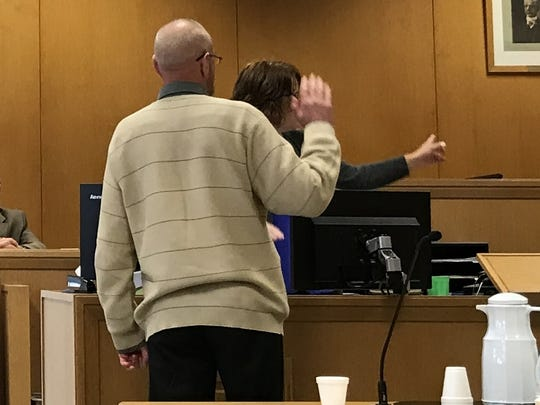 A clerk directs Mark Kusters to the witness stand after he took an oath to tell the truth during his trial Tuesday afternoon.