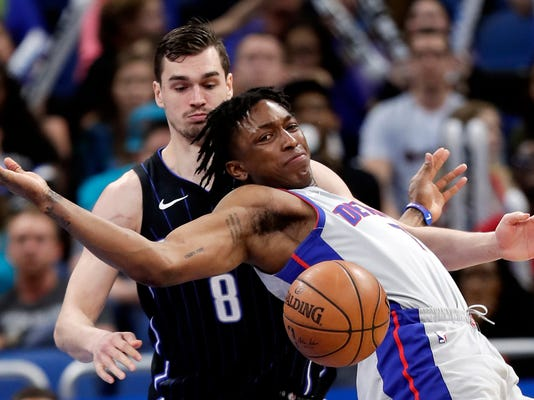 Detroit Pistons' Stanley Johnson, right, loses control of the ball as he tries to get around Orlando Magic's Mario Hezonja (8) during the second half of an NBA basketball game, Friday, March 2, 2018, in Orlando, Fla. (AP Photo/John Raoux)