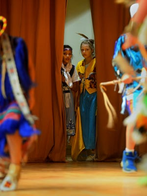 Dancers watch from the wings as the boys perform their dance during the Native American Heritage Week assembly at West Elementary School on Thursday morning.  The 22 dancers were made up of elementary school students from around the Great Falls district.