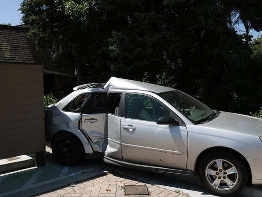 A truck driver hit a power box, two cars and a tree