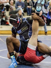 Brookfield East wrestler Dominique Lopez (bottom) grapples with Whitefish Bay/Dominican/University School wrestler Dajun Johnson during the WIAA D1 sectional at Homestead on Saturday, Feb. 17, 2018.