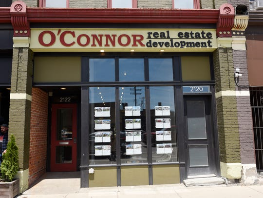 Agents at O' Connor real estate development in Corktown