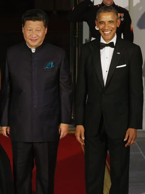 Chinese President Xi Jinping and President Obama pose for photographers before a state dinner at the White House on Sept. 25, 2015.