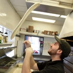 New MSU grad moves from driver to boss at Pizza Cutter