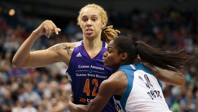 Brittney Griner (42) had 14 points and 11 rebounds in her season debut.
