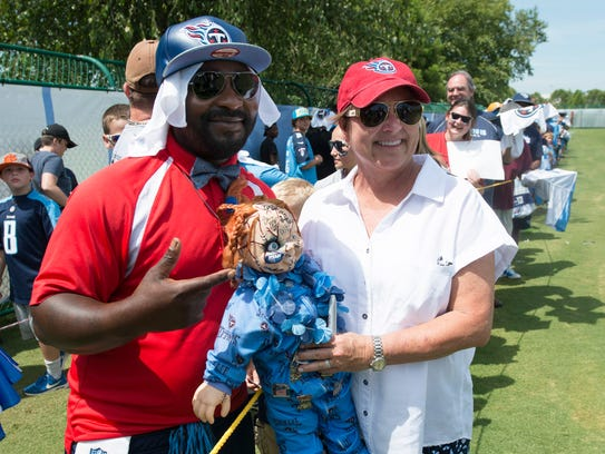 Titans owner Amy Adams Strunk pose with Titans fan