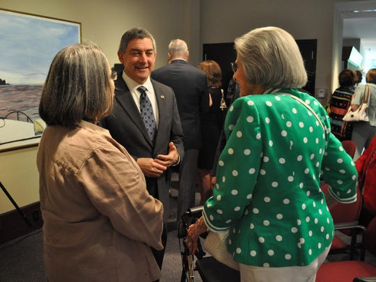 Lt. Gov. Jay Dardenne talks with Catherine Pears (left) and Fran Davis (right) after announcing the Alexandria Museum of Art as the new home for Louisiana's State Art Collection.