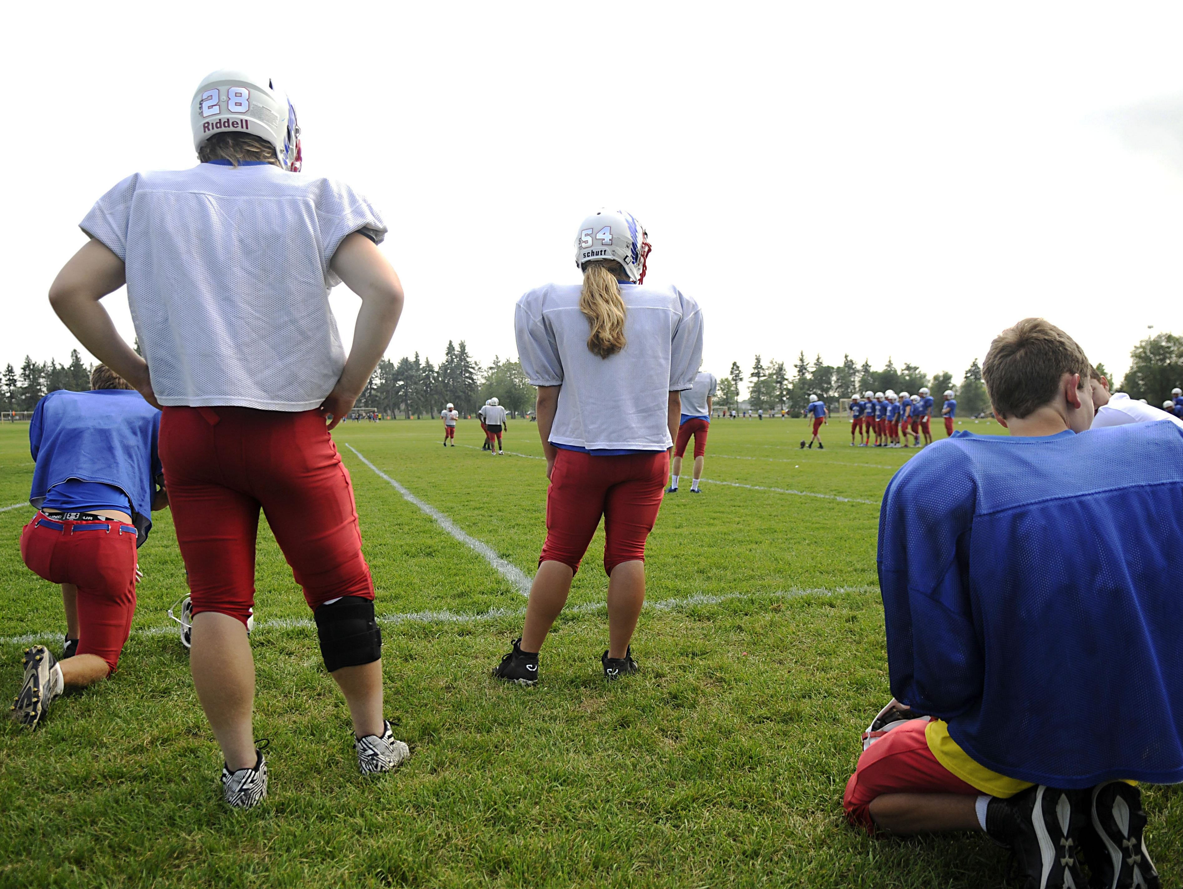 Linebacker Angie Stolt waits to go into the play at practice on Wednesday at Apollo High School.