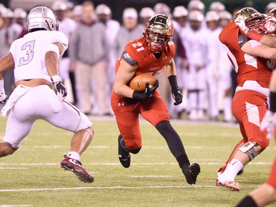 Non-Public Group 4 state football final at MetLife Stadium in East Rutherford, on Friday, December 01, 2017.  BC #21 Johnny Langan runs with the ball in the first quarter.