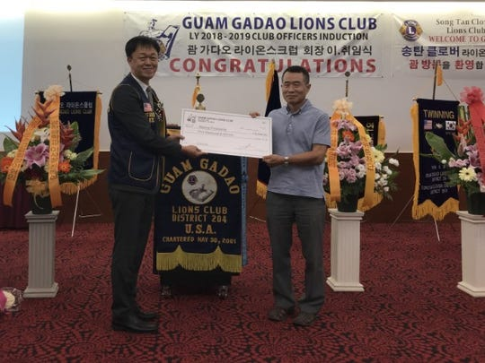 Guam Gadao Lions Club donated $2,000 to the Manna Fellowship July 6. Manna Fellowship community serves meals to the homeless. Pictured from left: Kang Haeng Lee, president, and Manna Fellowship Pastor Byeon Seongyu.