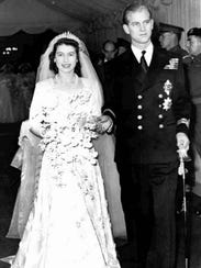 Queen Elizabeth II and her husband Prince Philip, leave