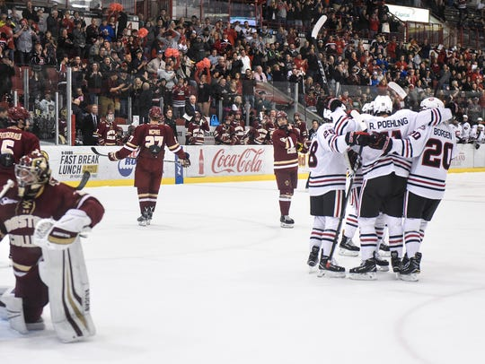 St. Cloud State players celebrate one of three goals