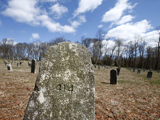 A stone headstone is shown at the Marlboro Psychiatric Hospital cemetery on Thursday, April 5, 2018.